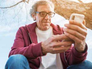 Friend-In-Need scheme - man using technology